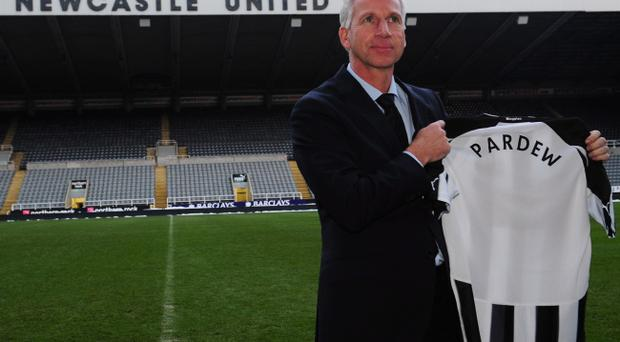 Alan Pardew familiarises himself with his new surroundings at St James' Park yesterday but the fans don't expect him to perform miracles