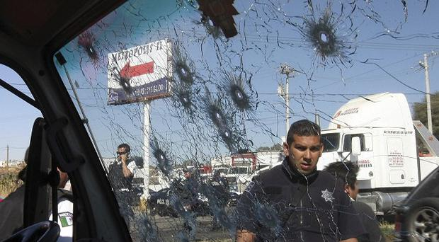 A bullet riddled truck window on a road leading to the city of Morelia, Mexico (AP)