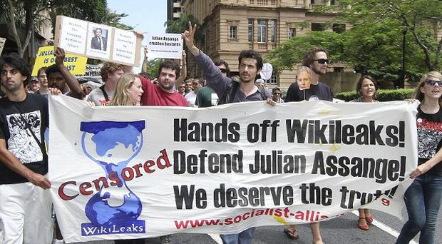 Hundreds of protesters march through Brisbane's city centre to protest against the detention of WikiLeaks founder Julian Assange (AP)