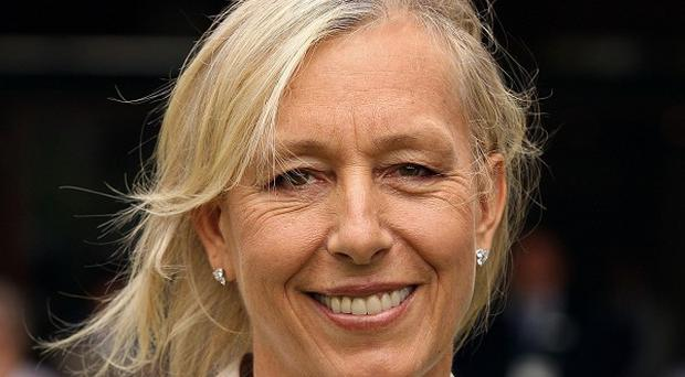 Martina Navratilova has abandoned her maiden attempt to climb Africa's highest mountain after falling ill