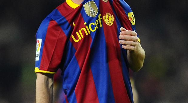 Lionel Messi will be wearing a new Barcelona shirt after the club agreed a new deal.