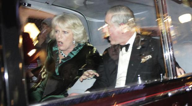 Britain's Prince Charles and Camilla, Duchess of Cornwall react as their car is attacked, in London, Thursday, Dec. 9, 2010