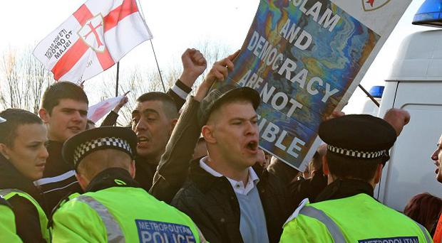 Members of the English Defence League demonstrate during a march through the centre of Peterborough, Cambridgeshire