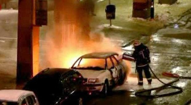 Emergency services as they attend the scene after two cars exploded in the center of Stockholm (AP/TV4)