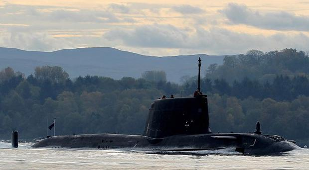 HMS Astute had to head back to its base in Faslane after what officials described as a 'minor defect'