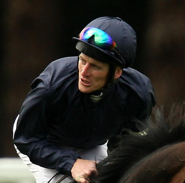 Johnny Murtagh in the familiar Coolmore colours