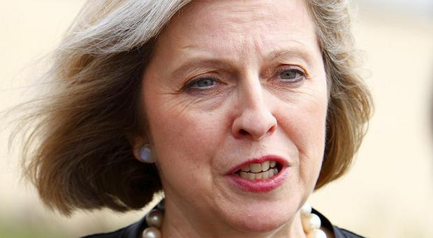 Theresa May has urged Britons to be vigilant after bomb explosions in Sweden