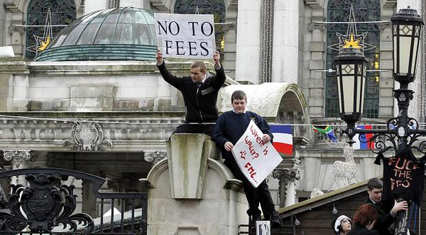 Hundreds of students stage a protest in Belfast city centre against plans to raise tuition fees in England (AP)