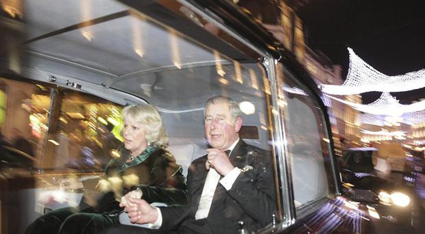 Charles and Camilla's car was attacked during the protests (AP)