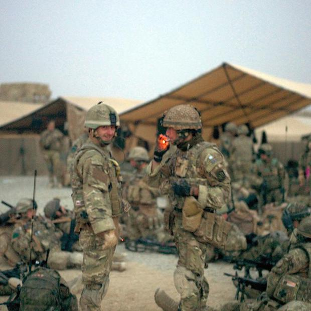 Troops in Afghanistan move out before an advance into the Tor Ghai settlement to drive out insurgents