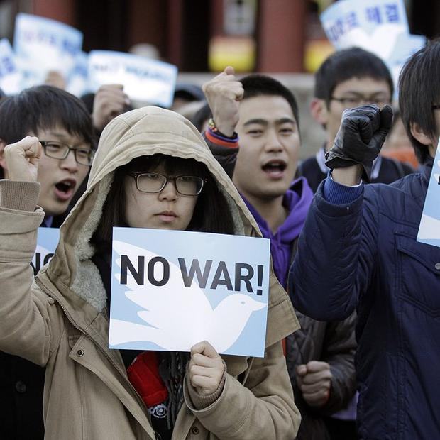 Anti-war protesters shout slogans during a rally against South Korea's policy for North Korea in Seoul (AP)