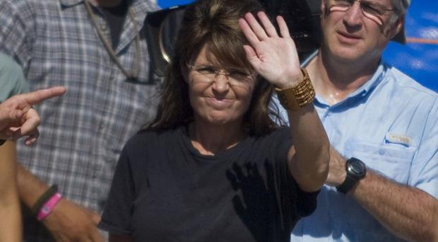 Sarah Palin urged Americans not to forget Haiti as she wrapped up a weekend visit to an aid group's sites in the country (AP)