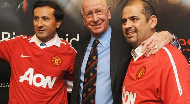 Sir Bobby Charlton meets the rescued Chilean miners Raul Bustos (left) and Mario Sepulveda