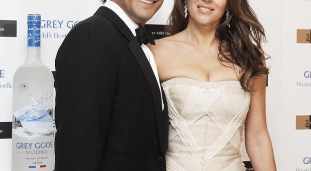 Liz Hurley has confirmed her split from husband Arun Nayar