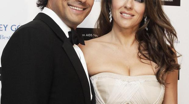 Liz Hurley and husband Arun Nayar have separated, the actress announced on her Twitter feed