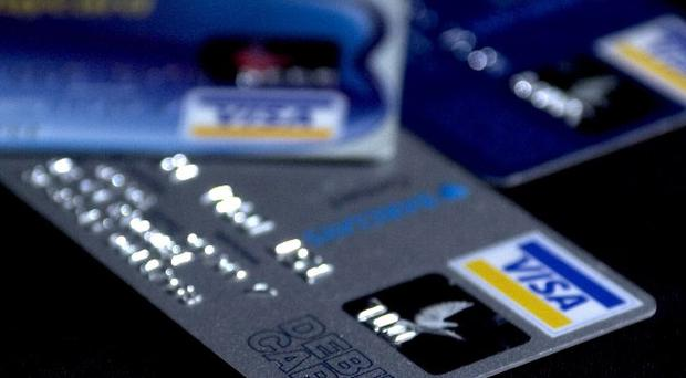 More than half of households are struggling to repay credit cards and loans, a Bank of England survey said