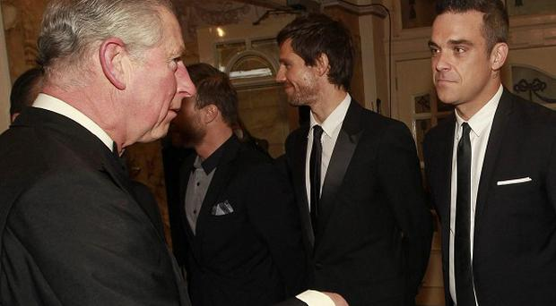 The Prince of Wales meets Take That ahead of the Royal Variety performance