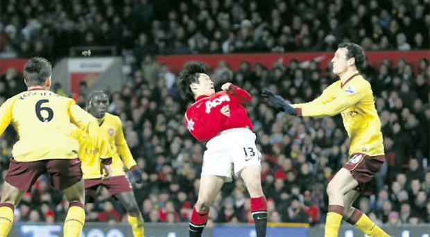Ji-Sung Park scores the only goal of the game for Manchester United with a tremendous twisting header