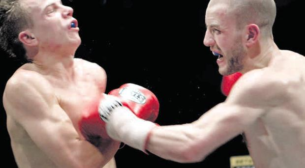 Take that: Champion Martin Lindsay on his way to victory over Paul Appleby, who holds a points victory over challenger John Simpson