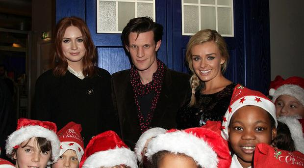 Karen Gillan, left, Matt Smith and Katherine Jenkins at a preview screening for the Doctor Who Christmas Special