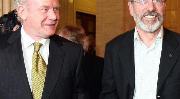 Gerry Adams (right) and Martin McGuinness were aware of the £26.5 million robbery in the Northern Bank in Belfast, reports said