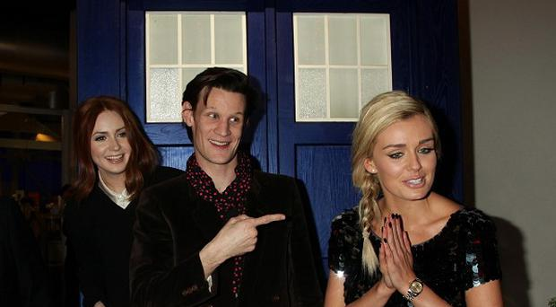 Karen Gillan (left), Matt Smith (centre) and Katherine Jenkins attend a preview screening for the Doctor Who Christmas Special