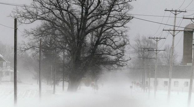 Blowing snow obscures a road in rural Lorain County near Grafton, Ohio