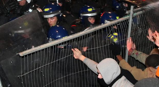 Police clash with demonstrators in Whitehall after the announcement to raise tuition fees