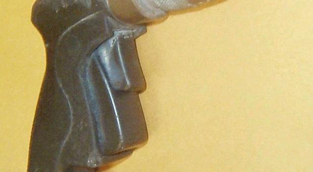 The black pistol grip water hose nozzle held by Doug Zerby before being fatally shot by Long Beach Police officers (AP)