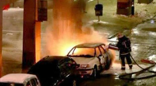 Emergency services attend the scene after a car exploded in central Stockholm on Saturday
