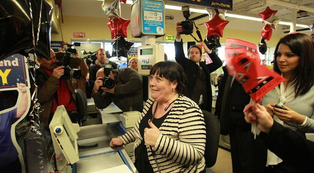 X Factor contestant Mary Byrne at her former workstation till 40 inside Tesco's as part of her official welcome home party at the Tesco Store in Ballyfermot in Dublin