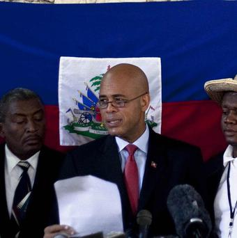 Haiti's presidential candidate Michel Martelly speaks during a news conference at his house in Port-au-Prince, Haiti