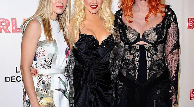(Left to right) Kristen Bell, Christina Aguilera and Cher arriving at the premiere of Burlesque
