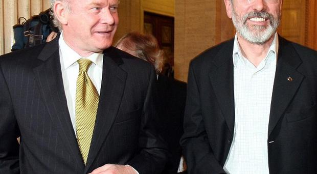Gerry Adams and Martin McGuinness deny having advance knowledge of the infamous Northern Bank raid