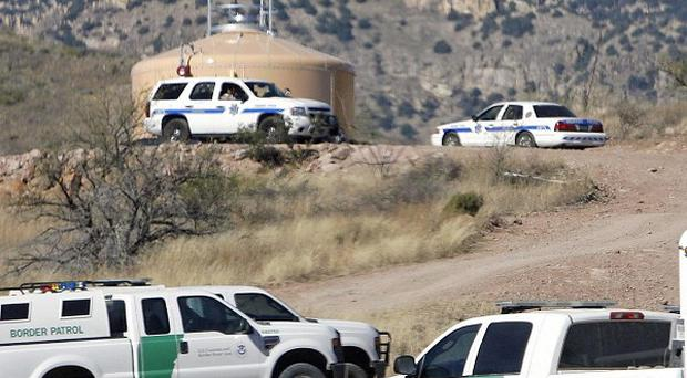 US Border Patrol and Arizona Department of Public Safety vehicles during a search for a suspect resulted in the death of a Border Patrol agent