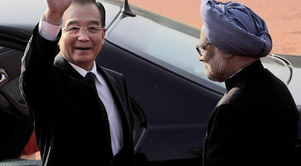 Indian PM Manmohan Singh, right, welcomes Chinese premier Wen Jiabao at the presidential palace in New Delhi (AP)