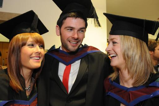 Caroline McElwee, Richard Fargher and Laura Beakley enjoy their graduation day after receiving their MA in Jounalisim from teh University of Ulster at the Winter Graduation ceremony at teh Millennium Forum. Picture Martin McKeown. Inpresspics.com