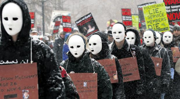 Anti-war protesters march to the White House yesterday to vent their anger against the wars in Afghanistan and Iraq
