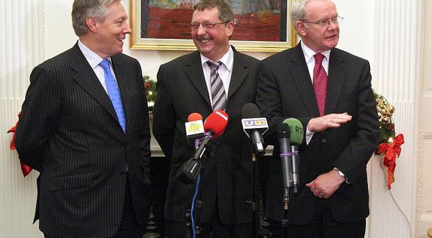 Peter Robinson, left, Martin McGuinness, right, and Sammy Wilson after a draft Budget was reached