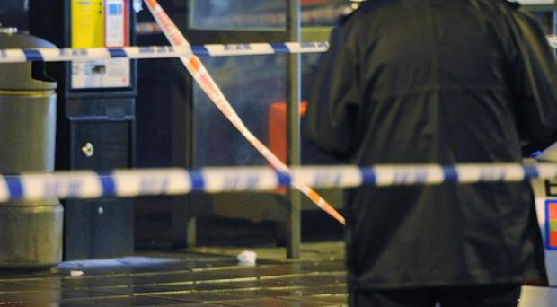 Forensic officers at the scene of the stabbing in New Broadway, Ealing, west London
