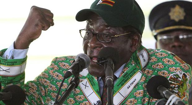 Zimbabwean president Robert Mugabe has vowed to fight against Western economic curbs (AP)