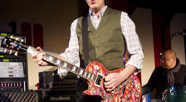 Sir Paul McCartney performs at the 100 Club