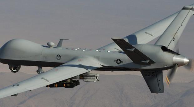 Two US missiles fired by unmanned drones killed 15 people in Pakistan (AP)