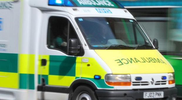 An injured man has died after the ambulance he was being treated in crashed