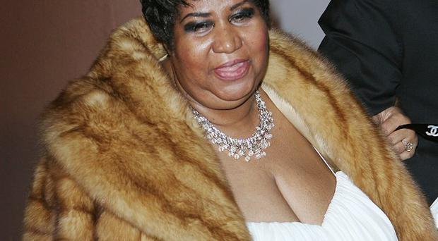 Aretha Franklin says she will soon reveal why she needed hospital treatment