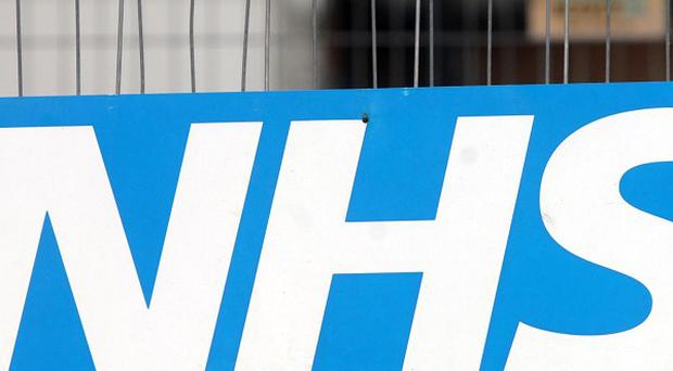 The NHS has been accused of putting a gun to workers' heads