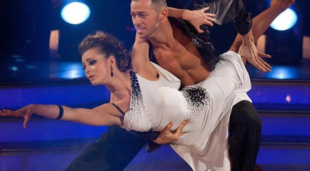 Kara Tointon and Artem Chigvintsev taking part in the Strictly Come Dancing final