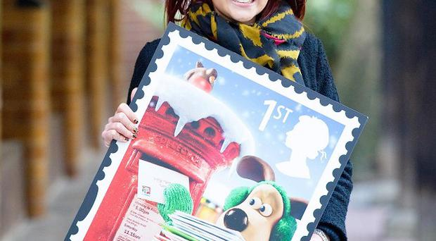 Actress Lacey Turner with this year's Christmas issue 1st class stamp, featuring the Queen's head