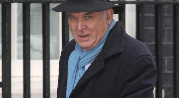 Business Secretary Vince Cable has pledged to take 'robust action' on the 'scandalous' payouts by banks