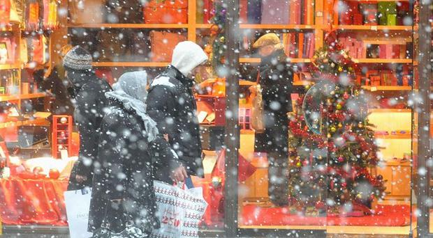 Retailers reported the 'best day of trading in years' as shoppers braved the wintry weather